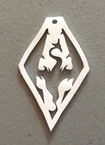Misshapen shrink plastic Akatosh pendant