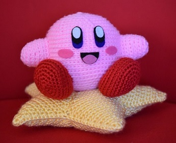 Amigurumi Kirby and his crocheted star pillow