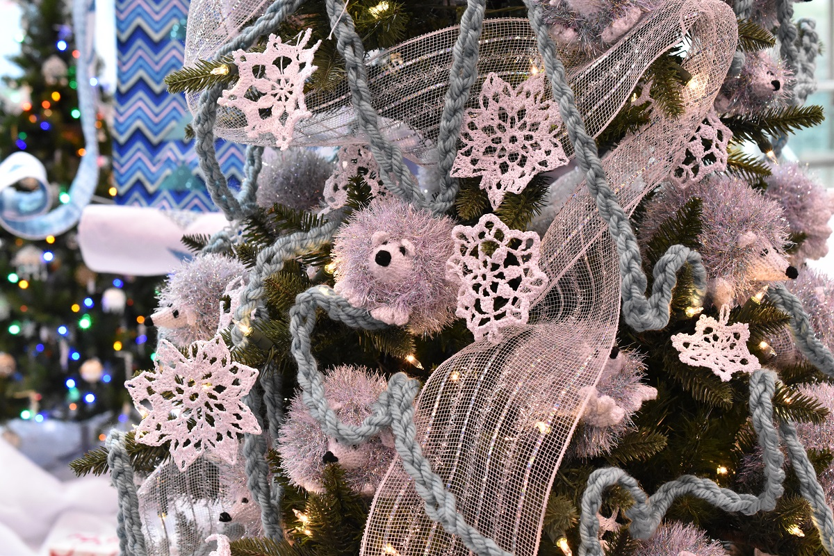 Christmas tree decorated in knit & crocheted hedgehogs and snowflakes