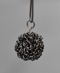 Silver and black wire bead pendant